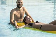Fun at the swimming pool Stock Photo