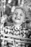 Fun on a swing Royalty Free Stock Image