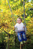 Fun on a swing Stock Image