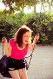 Fun on  swing Royalty Free Stock Photography