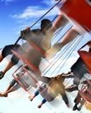 Fun on the swing at the steam fair Stock Photos
