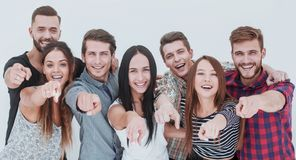 Fun team of young people pointing at you stock photo