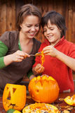 Fun time carving a jack-o-lantern for Halloween Stock Photography
