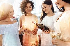 Positive joyful women enjoying their drink Royalty Free Stock Images