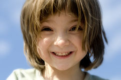 Fun times. Adorable excited little girl looking down at the camera royalty free stock images