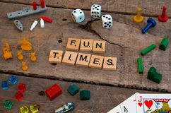 `Fun Times` made from Scrabble game letters. Risk, Battleship pieces, Monopoly, Settler of Catan and other game pieces stock photo