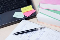 Fun times while studying for exams. With a laptop and colorful books royalty free stock photo