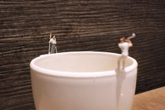 The fun of the tiny  golfers play on mug Royalty Free Stock Photo