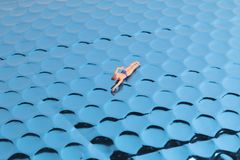Fun of Tiny toy in the sea Royalty Free Stock Photo