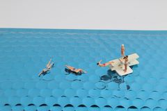 the fun of Tiny toy in the sea Royalty Free Stock Images