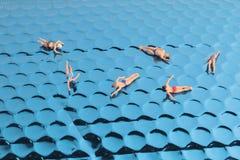 Fun of Tiny toy in the sea Stock Photo