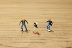Fun of Tiny toy skaters on table Stock Photo