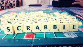 Fun to make words in Scrabble stock image