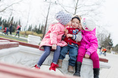 Fun toddlers playing in the park Stock Image