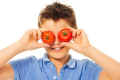 Fun with tomatoes Stock Images