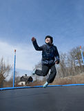 Fun on trampoline at springtime Royalty Free Stock Images