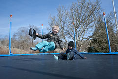 Fun on trampoline. Young boys having fun on a trampoline in early springtime Stock Photos