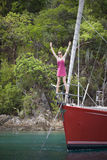 Fun in the tropics. Young women standing on the front of a luxurious sailboat in the tropics Stock Image
