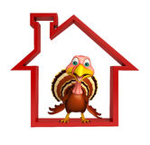 fun Turkey  cartoon character  with home sign Royalty Free Stock Photography