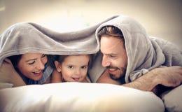Fun under blanket. stock photos