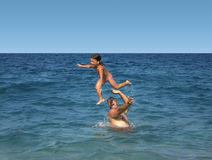 Fun in vacation. Father and daughter having fun in the water Stock Photos