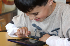Fun Video Game. Young boy has fun playing on his portable video game device Stock Photos