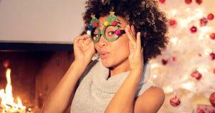 Fun vivacious young woman celebrating Christmas Stock Photos
