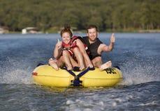 Fun On The Water. Tubing fun on a lake royalty free stock images