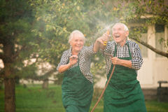 Fun with water hose. Royalty Free Stock Photo