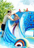 Fun in water park Royalty Free Stock Photo