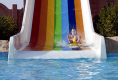 Fun on water slide Stock Images