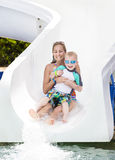 Fun on the water slide at waterpark Stock Photos