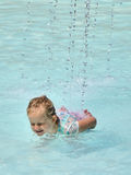 Fun with water in a swimming pool Stock Photos