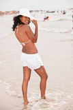 Fun at the waterfront. Beautiful brazilian girl having fun on the beach Royalty Free Stock Images