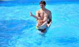 Fun in waterpool Stock Images