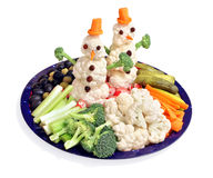 Fun way for kids to eat vegetables. The fun way to eat vegetables! Themed for winter holidays with cauliflower snowmen royalty free stock photo
