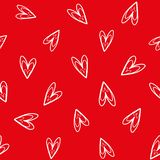 Fun white hand drawn doodle hearts on vibrant red background as seamless vector pattern. royalty free illustration