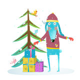Fun winter holiday rabbit for kids with fur tree and presents Royalty Free Stock Photo