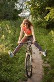 Fun woman on bike Stock Photo