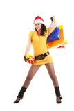 Fun woman with christmas gifts Royalty Free Stock Photography