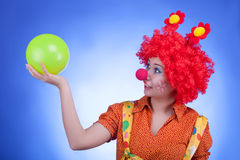 Fun woman clown on blue background Royalty Free Stock Images
