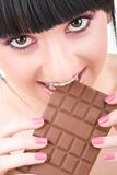 Fun woman eating chocolate Stock Photography