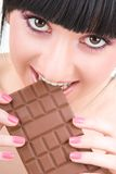 Fun woman eating chocolate Royalty Free Stock Photography