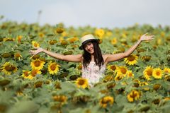 Fun woman in the field of sunflowers Royalty Free Stock Image