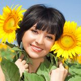 Woman in the field of sunflowers Royalty Free Stock Photos