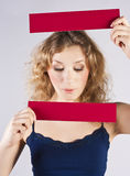 Fun woman holding a banner Stock Images