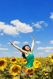 Fun woman jumping in the field Stock Photography