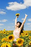Fun woman jumping in the field Royalty Free Stock Image