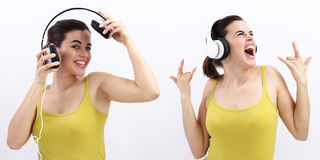 Fun woman listening to music in headphones Royalty Free Stock Images
