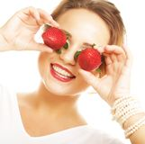 Fun woman with strawberry on the white background Stock Image